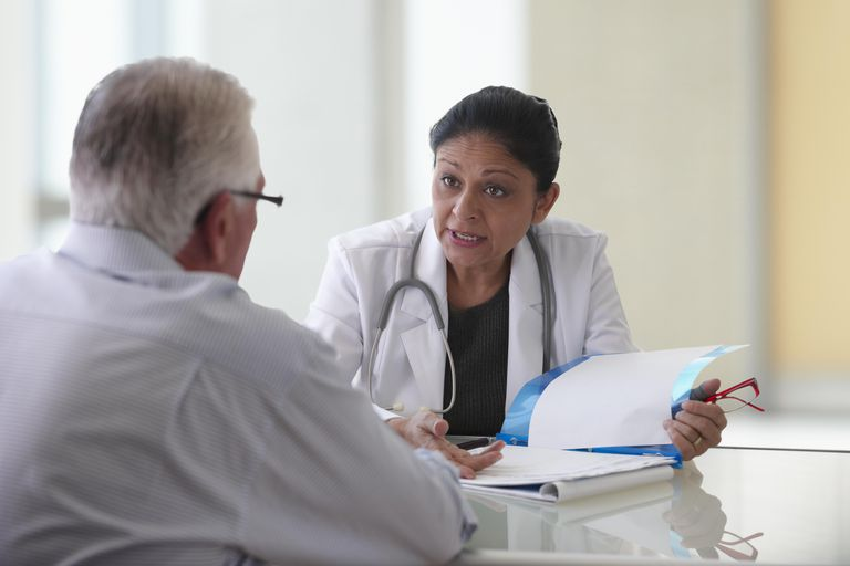 doctor talking to patient about lymph node metastases