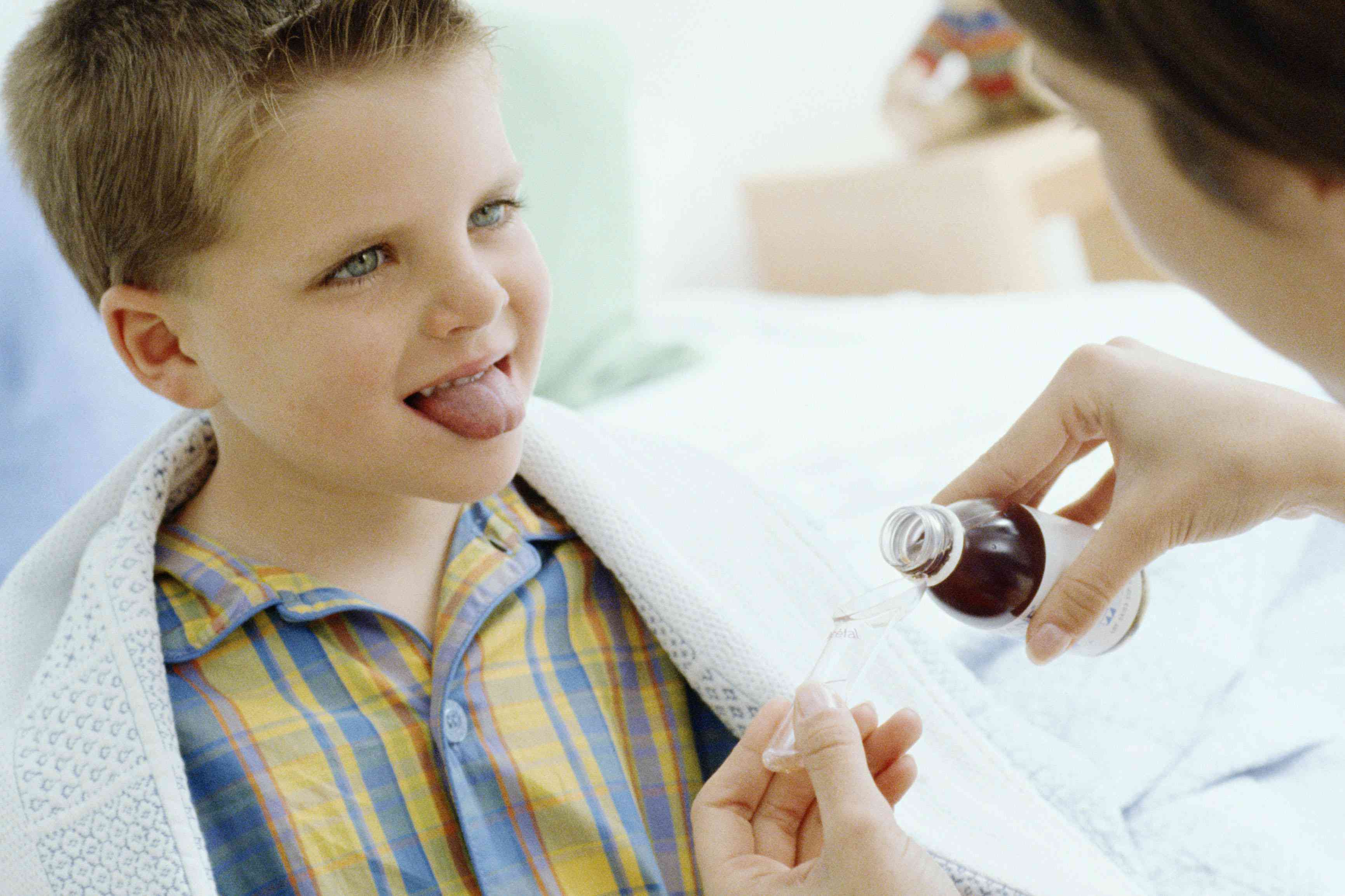 Mother giving son medicine