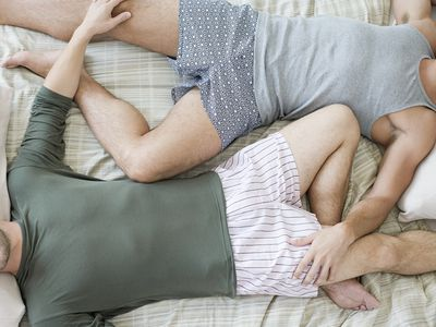 Gay couple in bed.