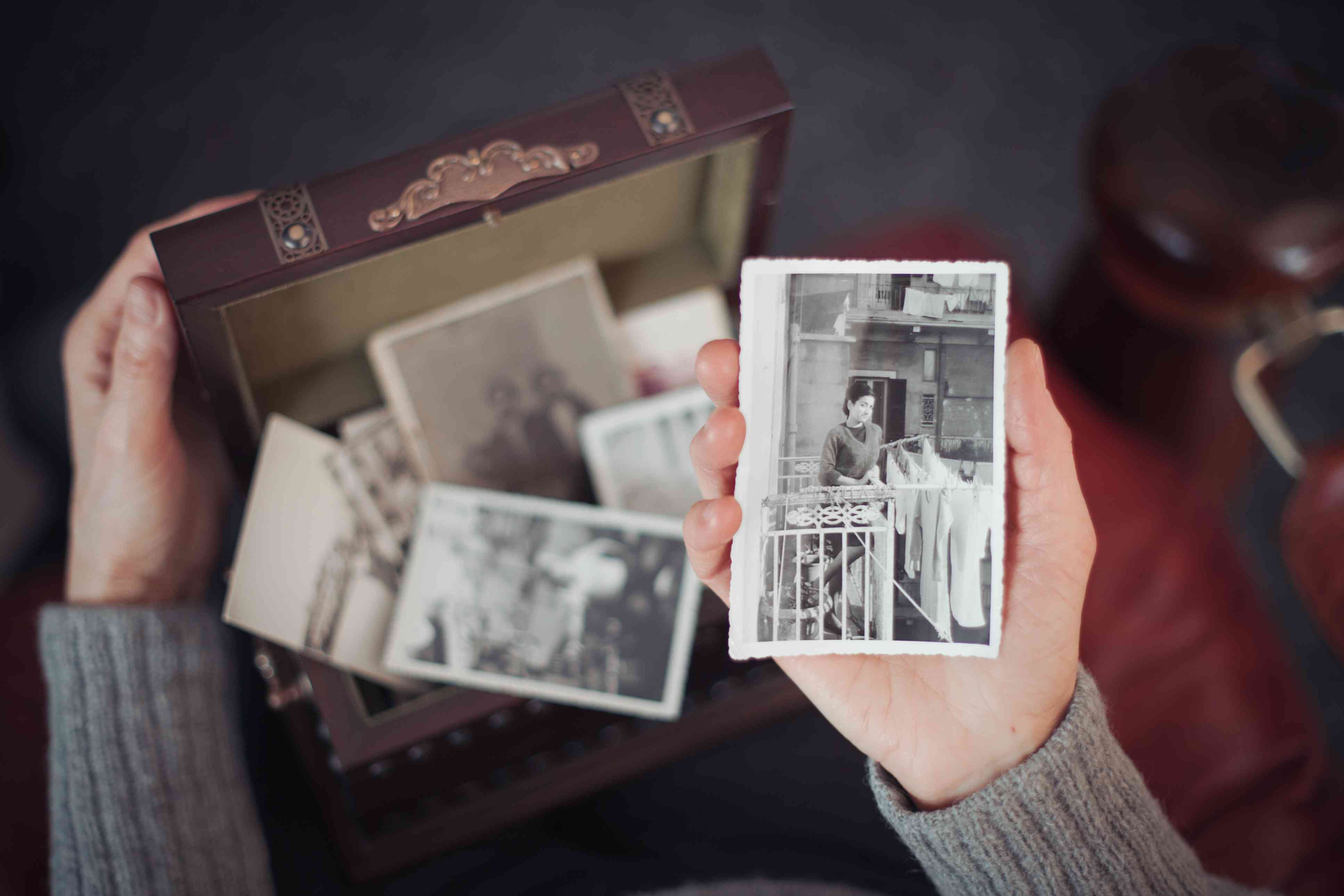Woman's hands holding old photos