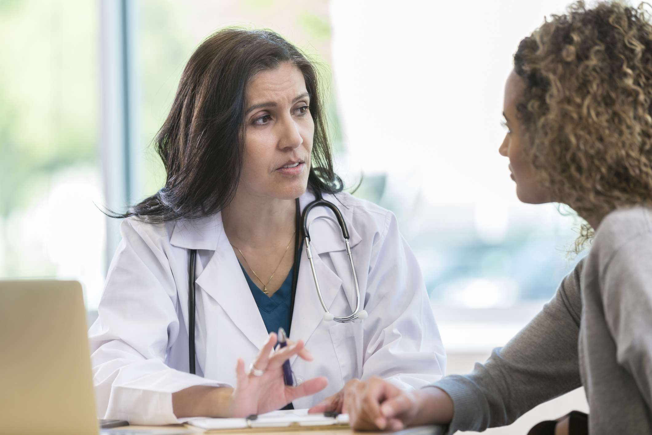 Doctor talking to her patient about her STD test