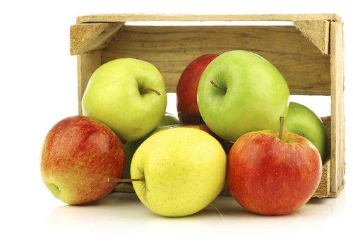 apples pouring out of a crate with white background