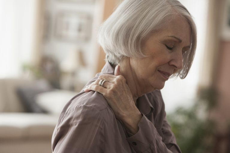 An elderly woman suffering from shoulder pain