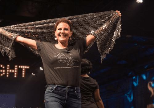 cancer survivor at fashion show on runway