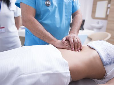 A doctor checking a patients spleen