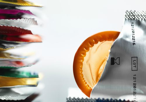 Stack of multi-colored condoms