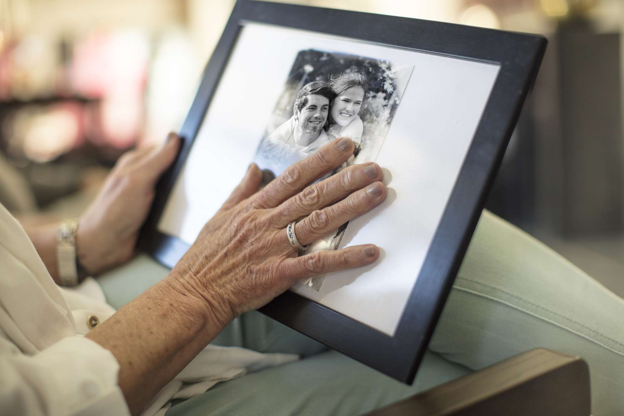 Grieving woman looking at photograph