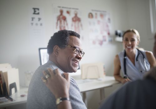 Man and his wife meeting with a doctor