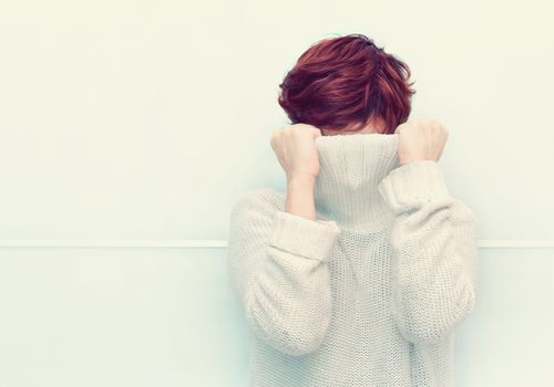 Woman Covering Her Face with sweater