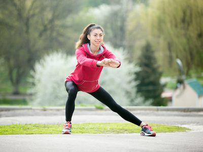 Woman doing a side lunge