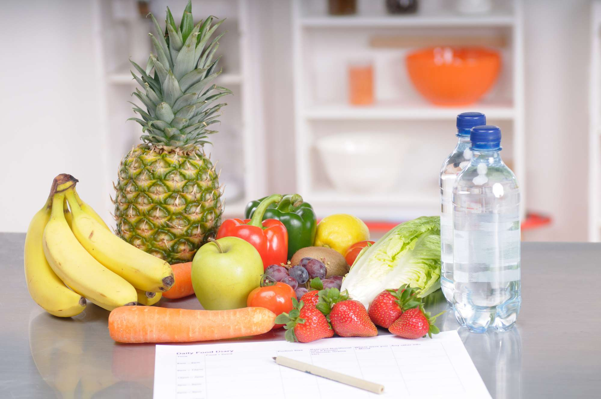 Fruits around a food journal