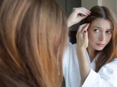 person checking scalp