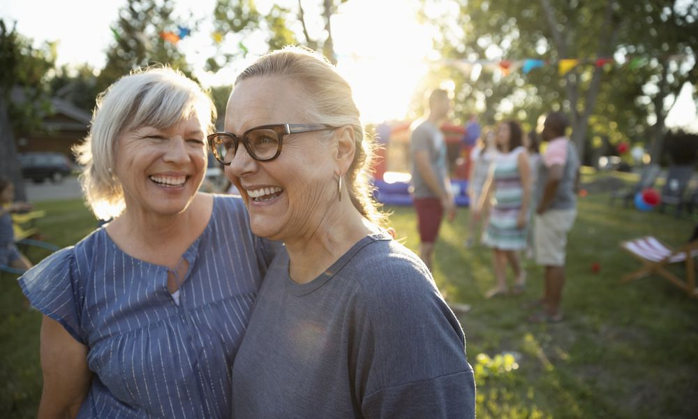 Two women having fun at an outdoor party