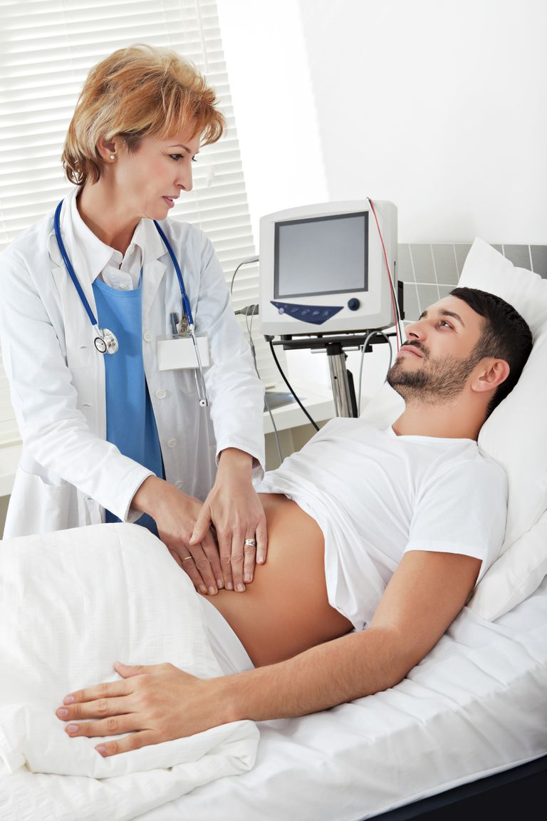 Female doctor examining a young man