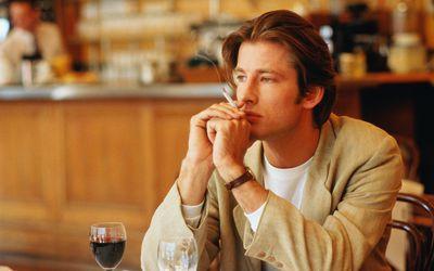 Man Smoking in Bar