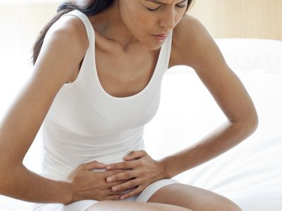 Young woman with stomach cramps