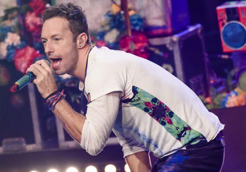 Photo of Chris Martin singing