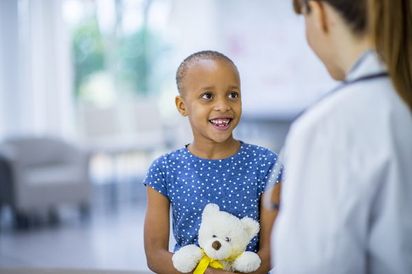 Child with cancer and her doctor