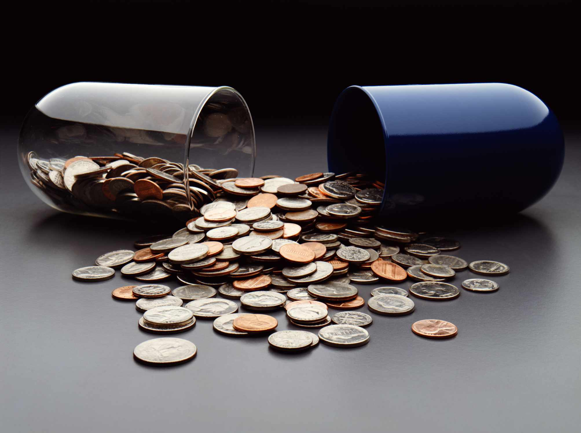 Large pill casing split apart with money coming out