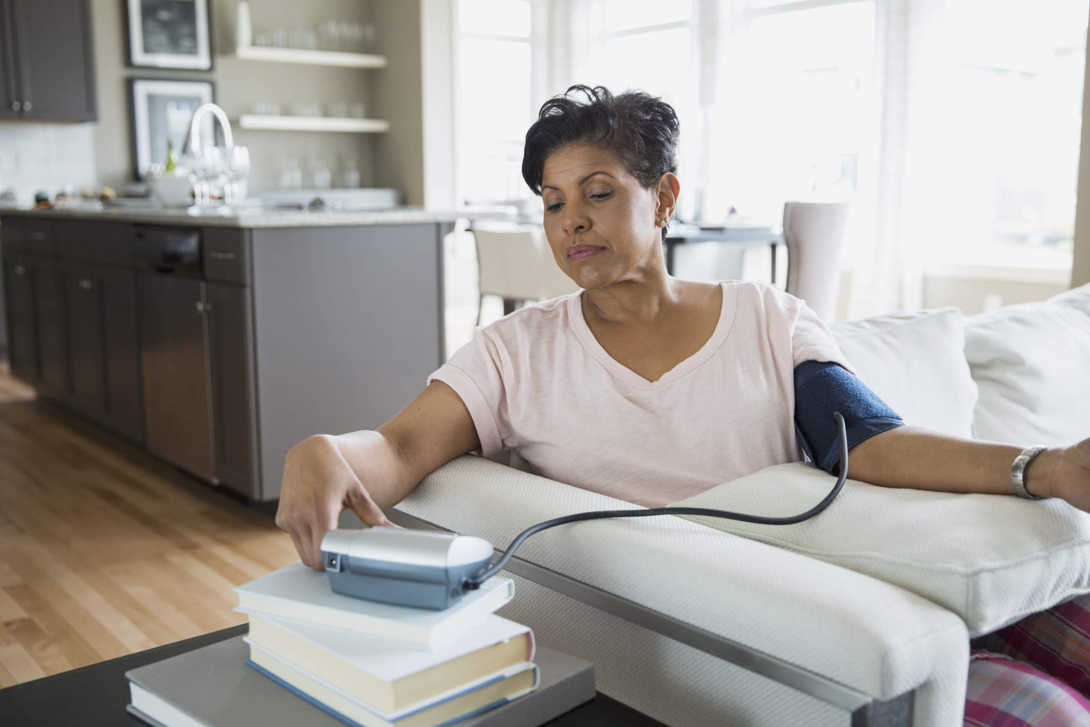 a woman checking blood pressure in living room