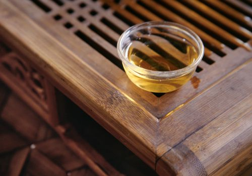 Pu-er tea in glass on bamboo stand