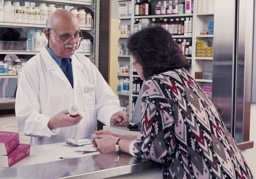 Woman talking with a pharmacist