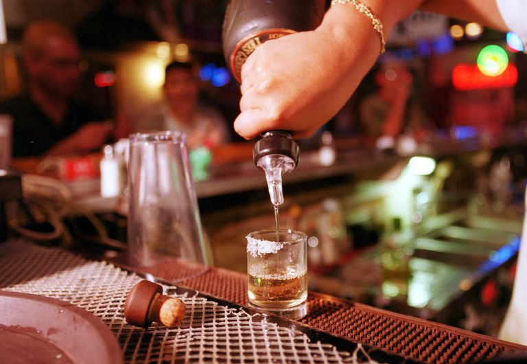 bartender pouring a tequila shot