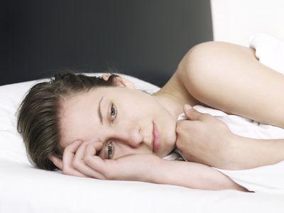 Woman laying awake in bed