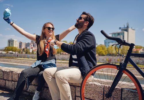 couple taking off masks after bike ride