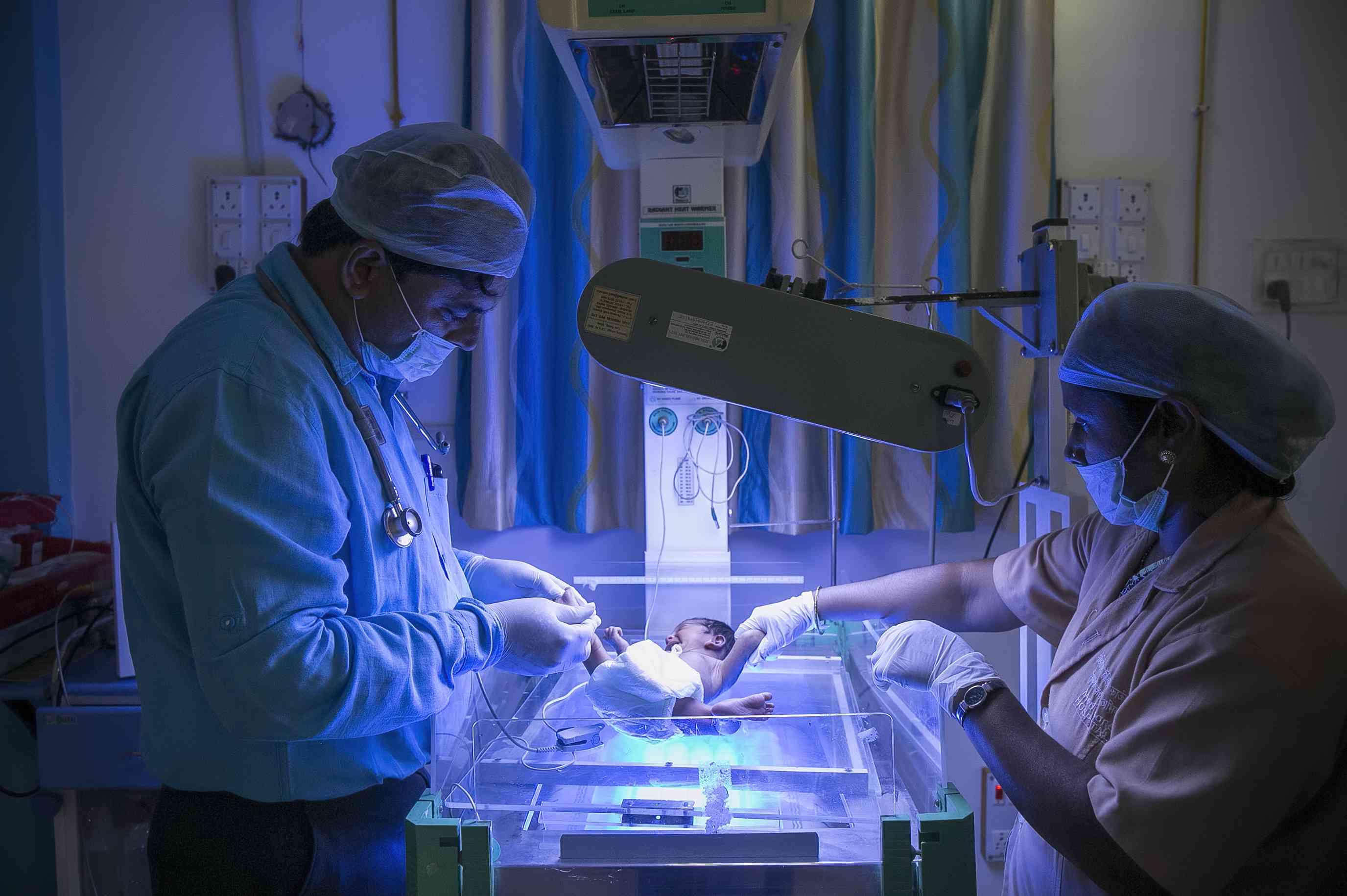 Doctor examining newborn