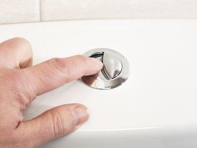 man flushing toilet