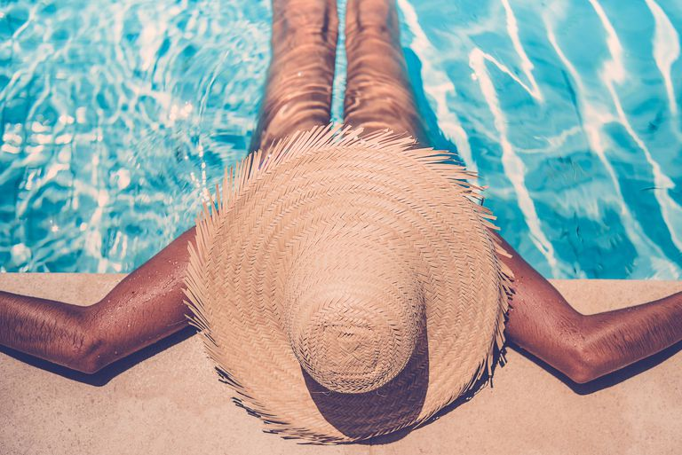 woman suntanning in a pool