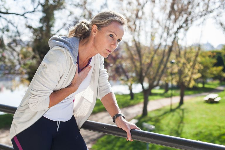 Woman out of breath because of physical activity