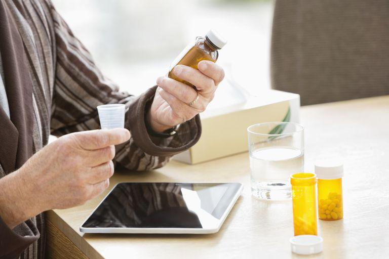 senior man looking at medications