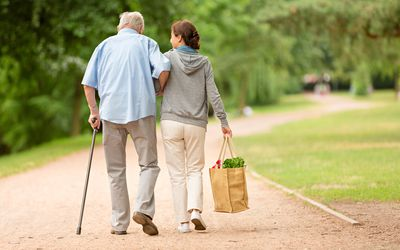 Caregiver helping man with shopping