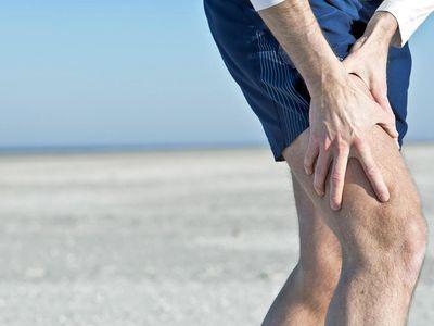 a man holding his thigh