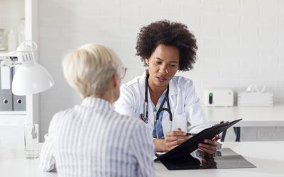 Mature woman at the doctor office come to consult about her health