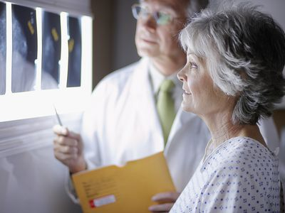 Woman reviewing X-Rays with doctor