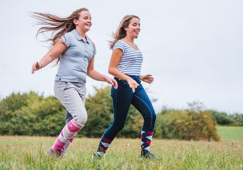 Teen girls running together