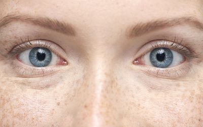 Close up of fair skin woman with blue eyes