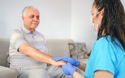 holding patient's hand for healthcare trust and support