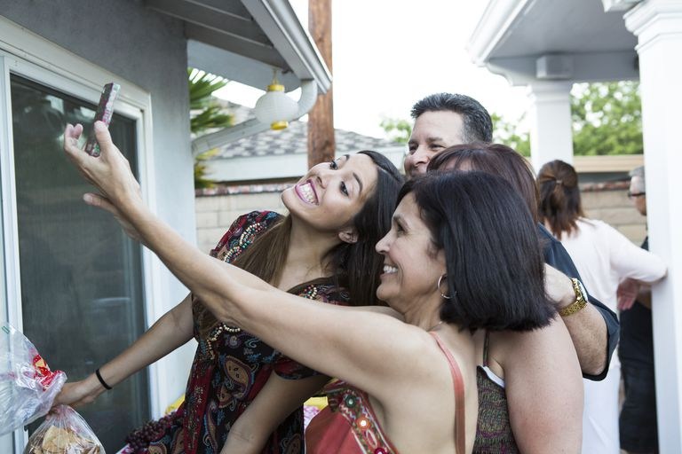 Hispanic Family taking a Selfie