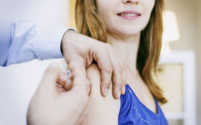 woman getting a shot in her arm