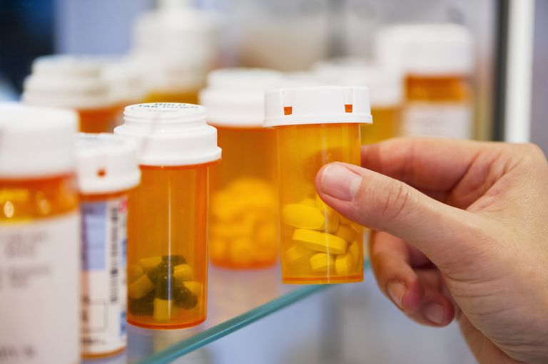 Pill bottles on shelf