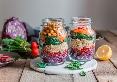 Colorful vegetables in jars