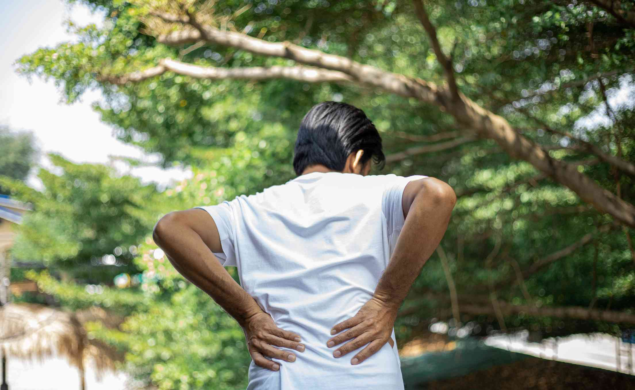 Person feels lower back pain