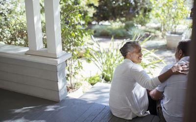 Older couple sitting on the porch