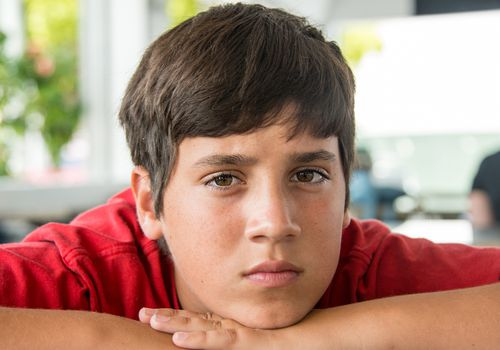 Boy with intense expression on his face