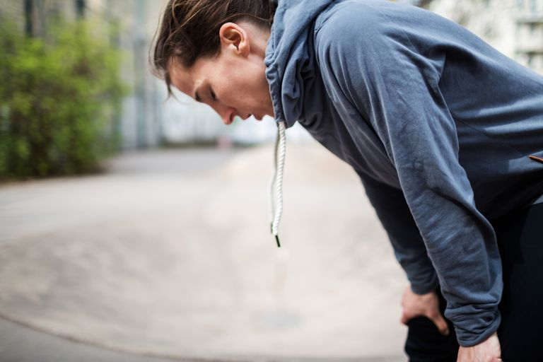 A woman out of breath from a run