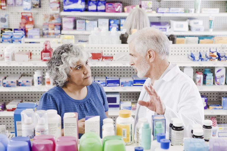 Pharmacist helping customer with over-the-counter products